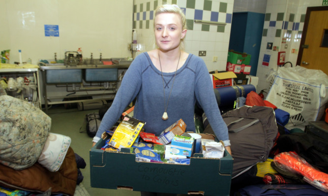 Charity founder Sammi Craig with donated food.