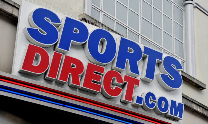 A sign above the Sports Direct store in Oxford Street, central London. PRESS ASSOCIATION Photo. Picture date: Wednesday January 6, 2016. Photo credit should read: Nick Ansell/PA Wire