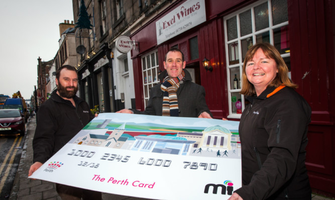 From left: Exel Wines general manager Russell Wallace, Miconex director Richard Gray and shop manager Keron Magee help to promote the Perth Gift Card.