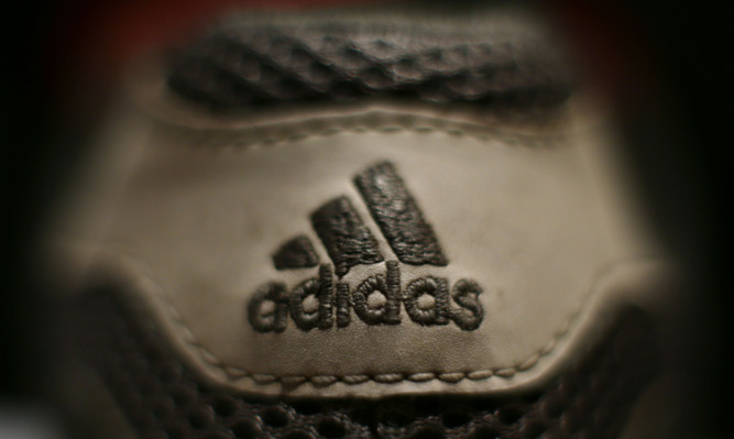 The Adidas logo on a pair of running shoes, London, as it has been reported that  the German sportswear company has terminated its sponsorship deal with the International Association of Athletics Federations (IAAF) four years early. PRESS ASSOCIATION Photo. Picture date: Sunday January 24, 2016. Photo credit should read: Yui Mok/PA Wire