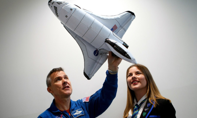 Former space shuttle pilot Flight Lieutenant Duane 'Digger' Carey talking to Hazel Barlow of Auchmuty High School, Glenrothes, during a visit to Fife last year