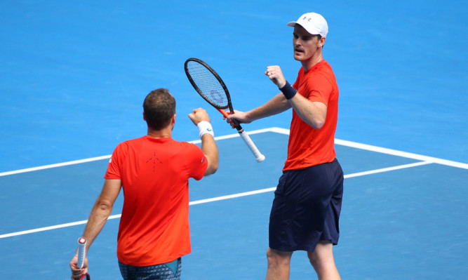 Bruno Soares and Jamie Murray (left) on their way to the men's doubles final.