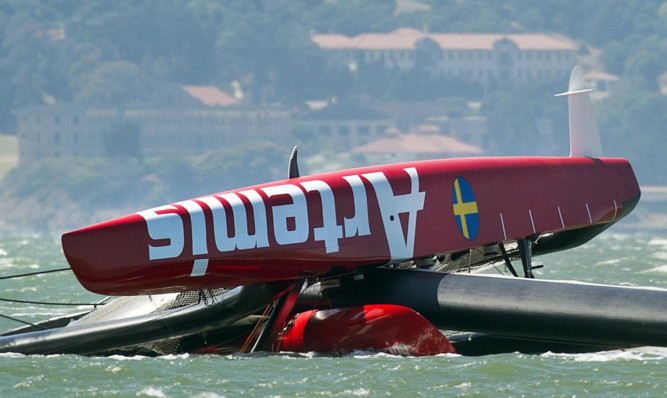 The Artemis Racing catamaran lies capsized after the tragic accident.