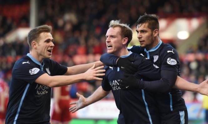 Gary Irvine celebrates scoring against Aberdeen last year.