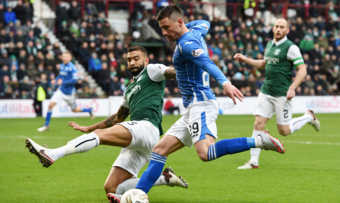 Michael O'Halloran is closed down by Liam Fontaine.