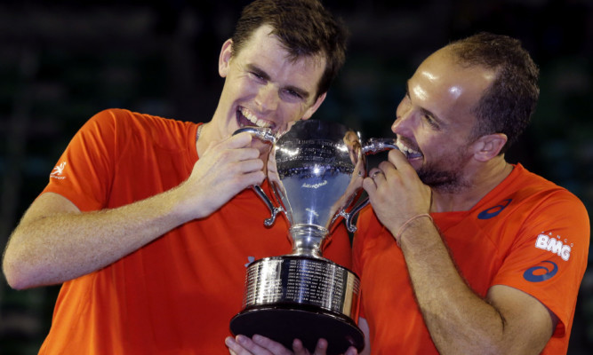 Jamie Murray and Bruno Soares hold their trophy.