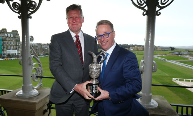 Martin Slumbers, Chief Executive of the R&A with European Tour CEO Keith Pelley and the Senior Open Championship Trophy.