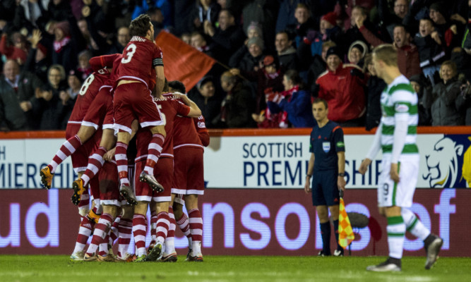 Aberdeen celebrate Jonny Hayes' opening goal as Leigh Griffiths looks on.