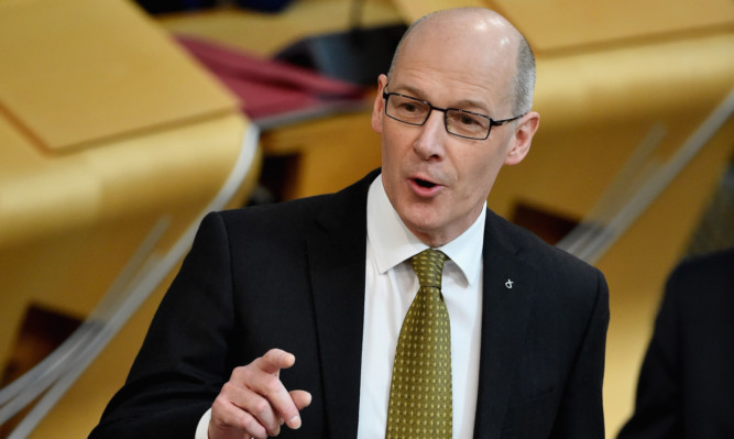 John Swinney has had to present some twists and turns on tax.