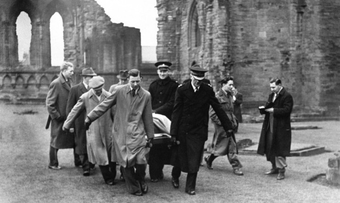 The Stone of Destiny being removed from Arbroath Abbey after the students' audacious stunt.