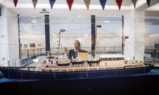 Royal Yacht Britannia employee Emma Aitken looks at the Lego model.