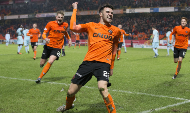 Scott Fraser celebrates after scoring the winner.
