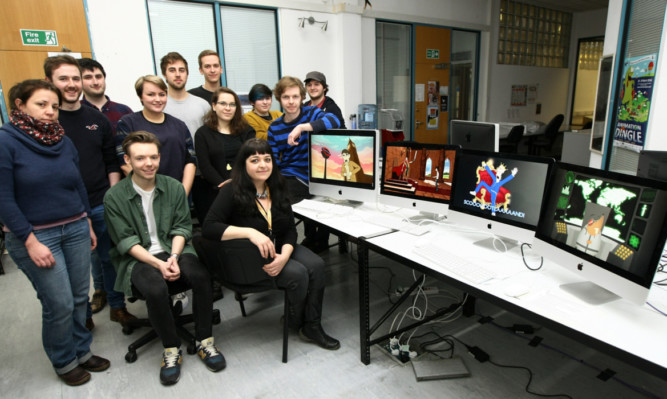 Course director Sharon Campbell, seated right, with some of the undergraduate animation students at Duncan of Jordanstone who have put TV licence non-payment excuses into action.