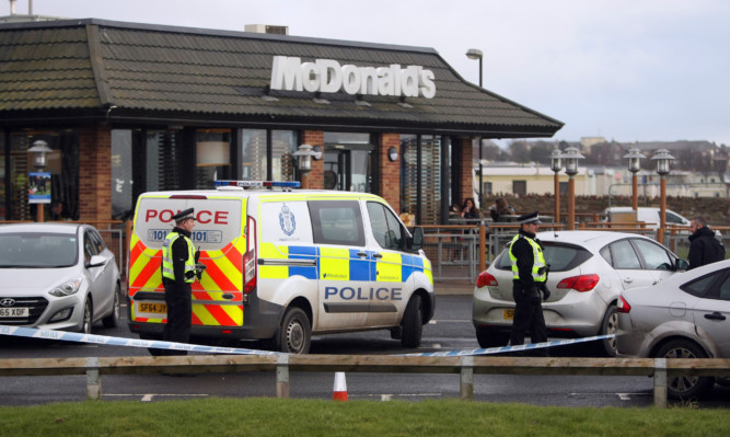 Police at McDonalds in Arbroath where a five men were detained in connection with an ATM raid in Carnoustie.