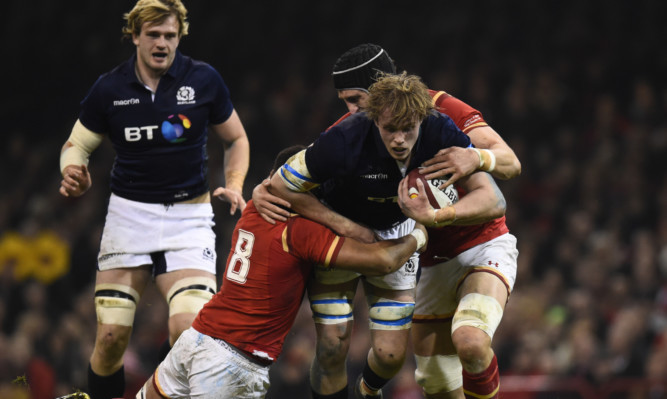 Jonny Gray carries the fight to Wales in Cardiff.