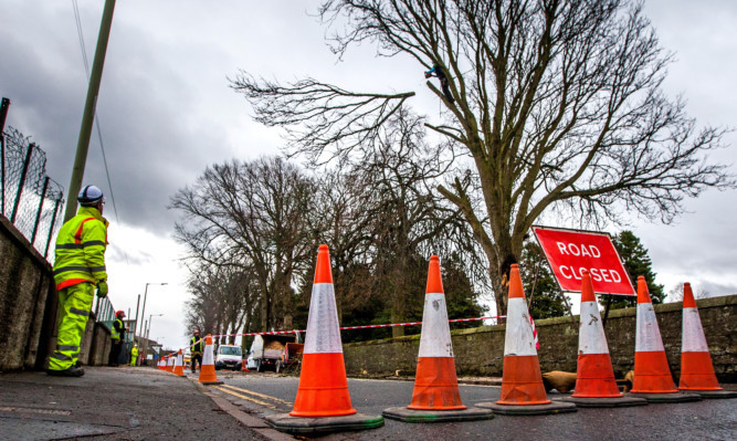 Feus Road is closed between junctions with Church Street and Longcauseway due to the dangerous tree.