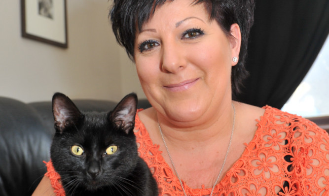 """Mo O'Sullivan with the cat, which they have called """"Tinkerbell""""."""