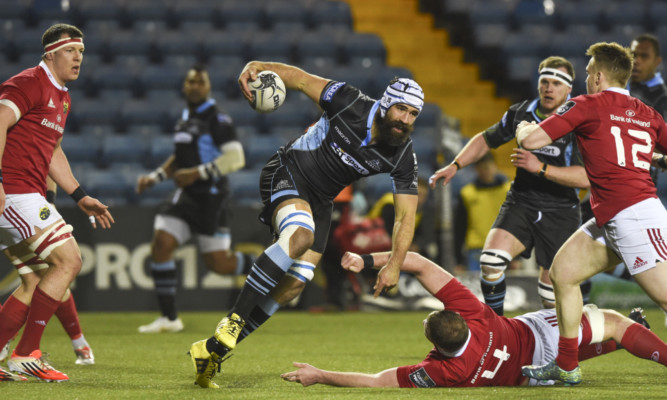 Josh Strauss charges through for Glasgow against Munster.