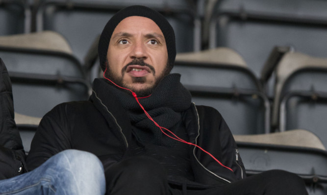 Julien Faubert watching Saints play Motherwell.