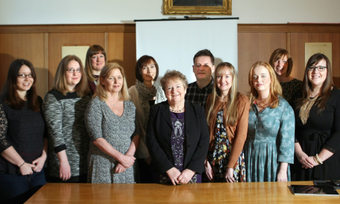 Councillor Sheena Welsh, convener for children and learning, with the new group of students.