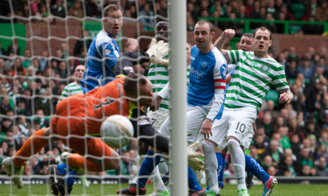 Anthony Stokes (right) watches as the ball heads into the net for Celtic's second goal.