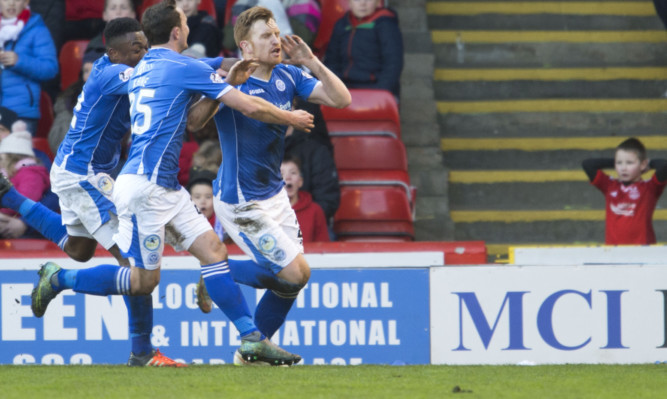 Liam Craig celebrates his goal, leaving at least one Aberdeen fan stunned.