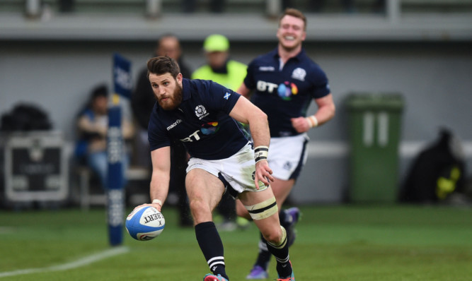 Tommy Seymour scores the clinching try after Stuart Hogg's off-load put him in.