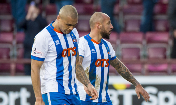 Kilmarnock's Josh Magennis (left) after the full-time whistle at Tynecastle.