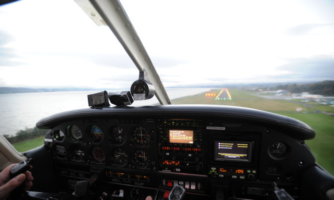 The laser was shone into the cockpit of the plane as it was landing at Dundee Airport.