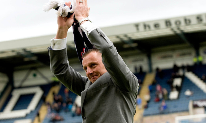 Dundee legend Rab Douglas applauds the fans during an emotional lap of honour at half-time as he prepares to leave the club.
