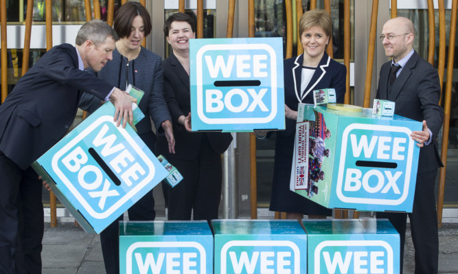 First Minister Nicola Sturgeon, Labour leader Kezia Dugdale, Liberal Democrat leader Willie Rennie and Conservative leader Ruth Davidson and Green Party convenor Patrick Harvey, will pose with giant WEE BOXES to highlight their support for SCIAF.