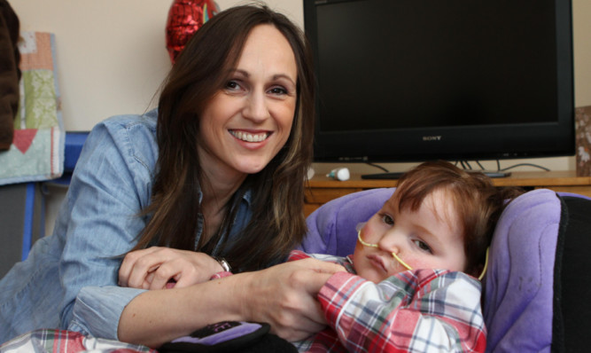 Jenny with son Blake. The three-year-old suffers from a rare physical condition.
