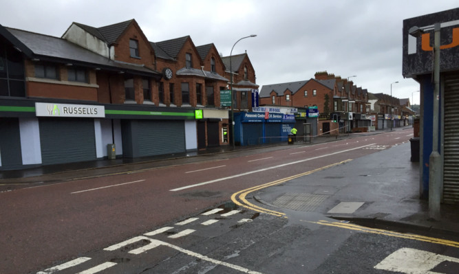 Police have sealed off a large area after a device exploded under a car in east Belfast.