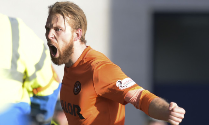 Henri Anier celebrates his first goal.