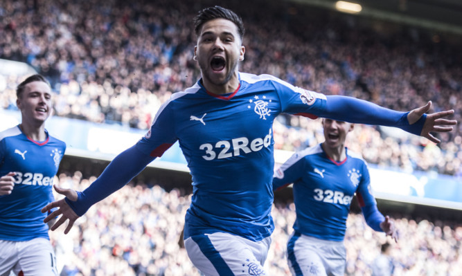 Harry Forrester celebrates opening the scoring in 13 seconds.