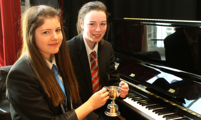 Caitlin Stewart and Lauren Anderson with the Arbroath Festival Trophy.