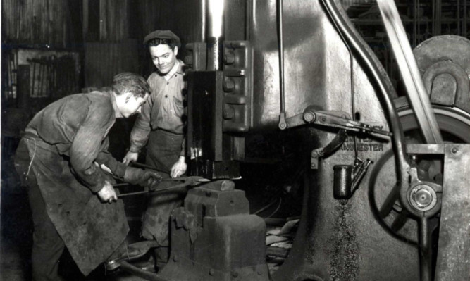 Men at work in the engineering shop at Burntisland Shipyard.