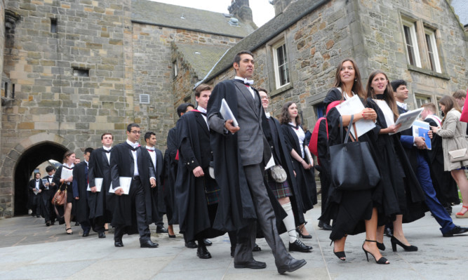 26.06.15 - pictured in St Salvador's Quad, North Street, St Andrews after the latest graduation ceremony for St Andrews University students - the procession arrives in the quad
