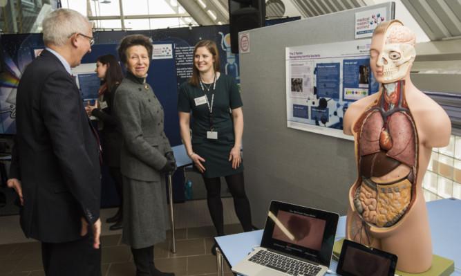 The Princess Royal chats to Prof Philip Winn Chairman of Medical Research Scotland and Jaclyn Carberry from the University of Glasgow.