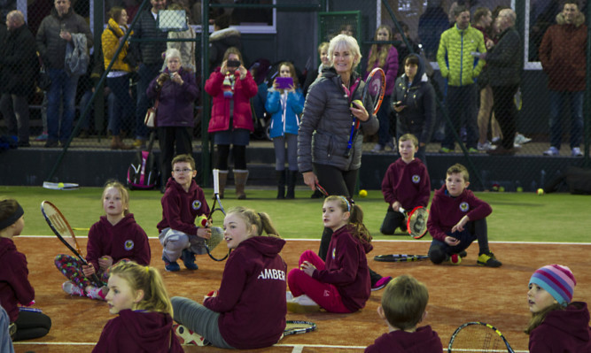 Judy Murray carries out a coaching session at the opening of the new all-weather courts.