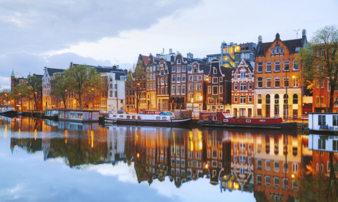 Flybe will begin direct scheduled flights between Dundee and Amsterdam in May.