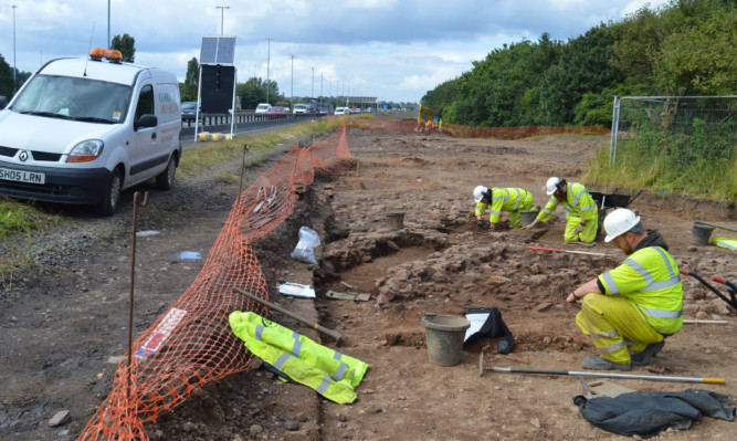 Archaeologists at work uncovering Cadzow by the M74 motorway.