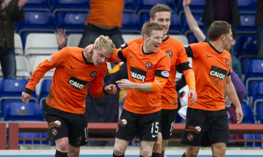 Gary Mackay-Steven (left) is hailed on his last minute winner for Dundee Utd.