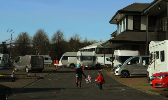 Travellers who camped on land at Dundee Technology Park.