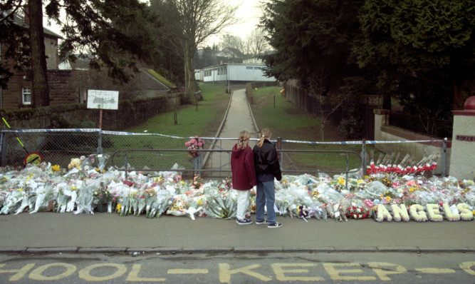 Tributes placed outside the school after the tragedy in 1996.