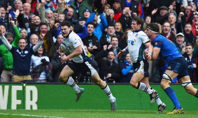 Duncan Taylor goes in for his solo try for Scotland against France.