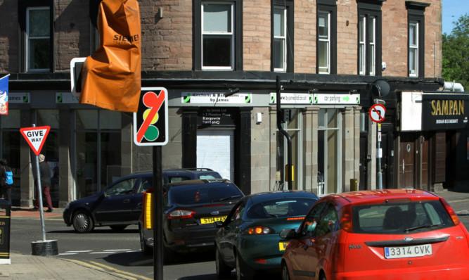 The unpopular traffic lights were scrapped last summer.