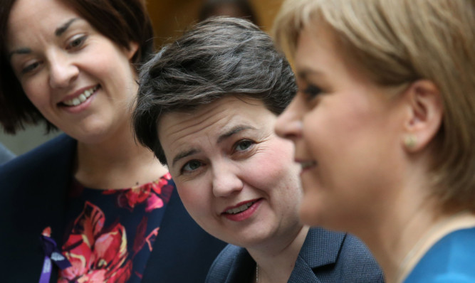The poll found Ruth Davidson (centre) may overtake Kezia Dugdale (left) to form the official opposition to Nicola Sturgeon's SNP.