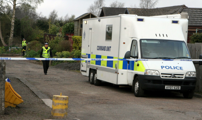 Police at Mr Gardners home after his body was discovered.