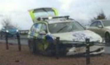 The police car slid into the central reservation barrier on the A9.